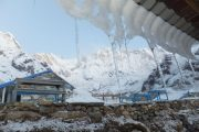 Annapurna Base Camp Trek: A wintry scene with icicles hanging from the teahouse at ABC