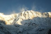 Mountains turning gold with the sunrise at Annapurna Base Camp