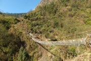 Lush green valley joined by a suspension bridge on the way to Annapurna Base Camp