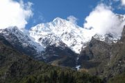 Forests and snow covered mountains on the way to Upper Pisang, Annapurna Circuit
