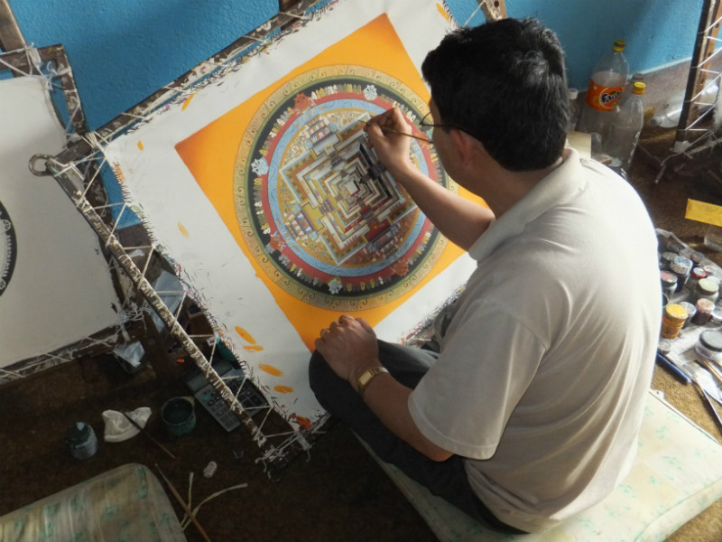 Master Painter in Bhaktapur painting a Thangka