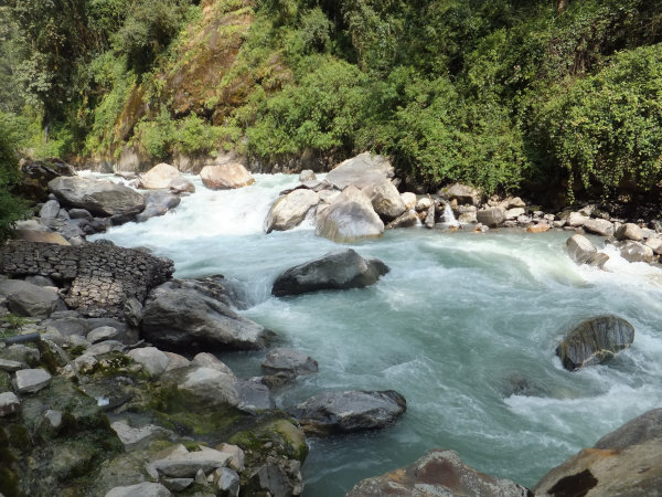 Modi Khola river rushing by the hot springs at Jhinu Danda