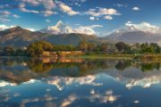 Phewa Tal reflecting the Annapurna massif in Pokhara, included in our Pokhara City Tour