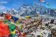 Tibetan prayer flags on top of Kala Patthar with view of Mount Everest, Everest Base Camp trek