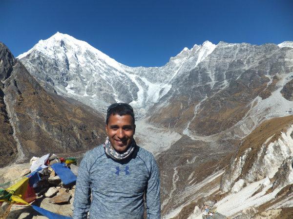 Trekking in the Langtang region: Krishna standing in front of Langtang Lirung