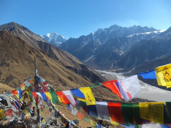 Trekking in the Langtang region: View from the top of Kyanjin Ri with Tibetan prayer flags