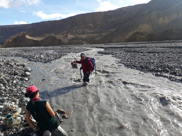 Trusted Nepal Trekking Guide Bibek Crossing a River in Upper Mustang