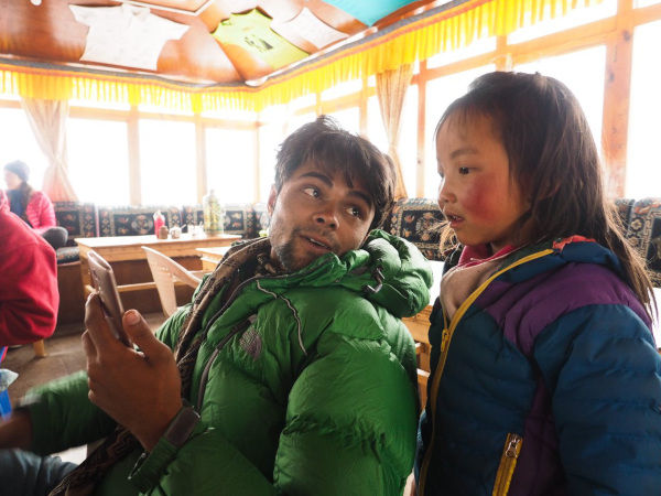Friendly Nepal Trekking Guide Ramesh with Girl in Teahouse