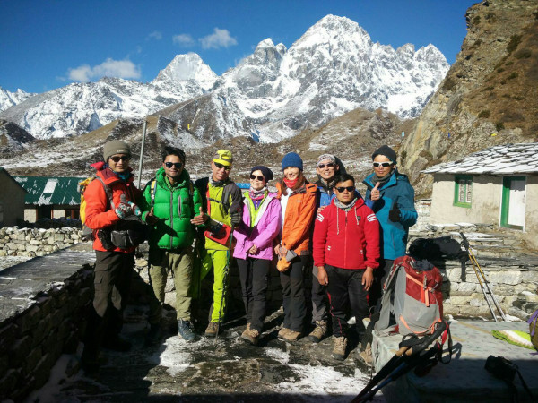 Friendly Nepal Trekking Guide Ramesh with Colourful Group