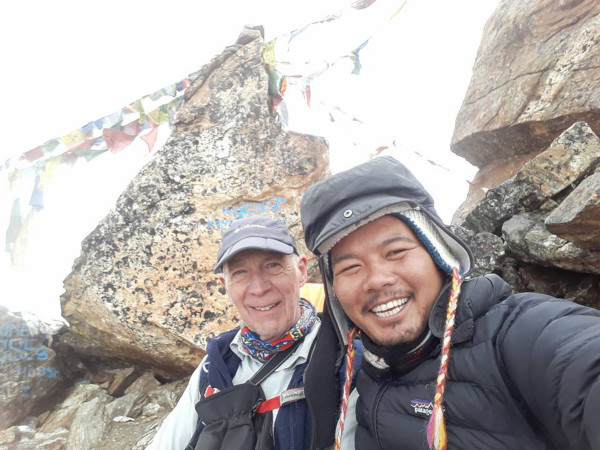 One of the best trekking guides in Nepal: Buddhi with his client