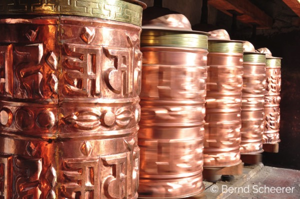 15 reasons to trek in Nepal - Copper prayer wheels spinning